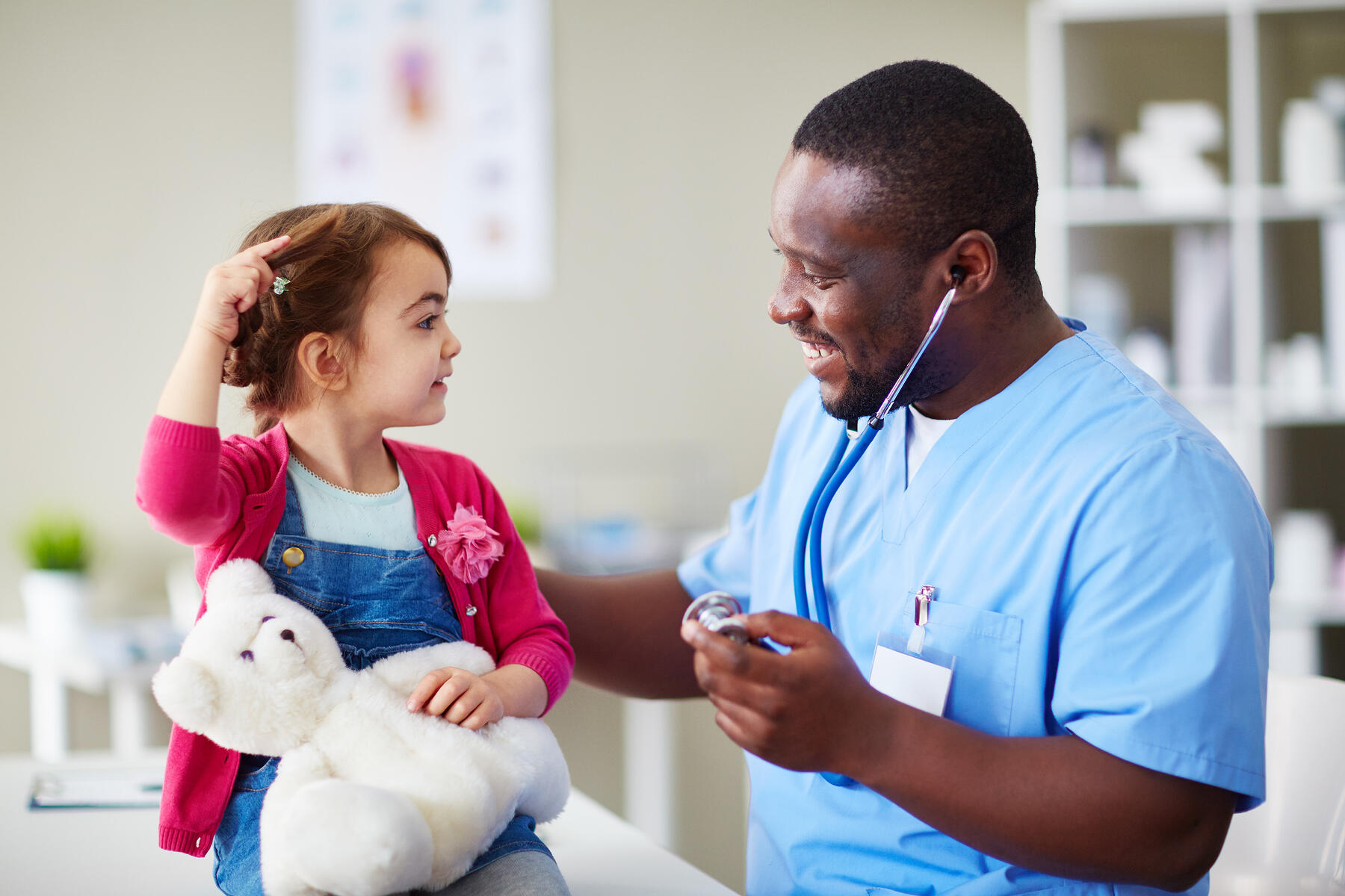 Doctor meets with young female patient